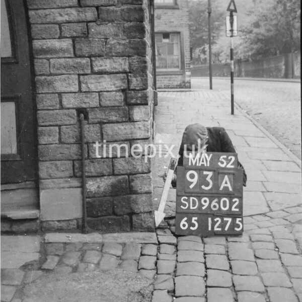 SD960293A, Man marking Ordnance Survey minor control revision point with an arrow in 1950s