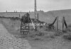 SD980142A, Man marking Ordnance Survey minor control revision point with an arrow in 1950s