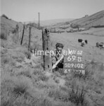 SD960269B, Man marking Ordnance Survey minor control revision point with an arrow in 1950s