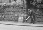 SD970288B, Man marking Ordnance Survey minor control revision point with an arrow in 1950s