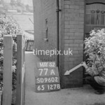 SD960277A, Man marking Ordnance Survey minor control revision point with an arrow in 1950s
