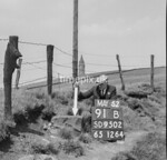 SD950291B, Man marking Ordnance Survey minor control revision point with an arrow in 1950s