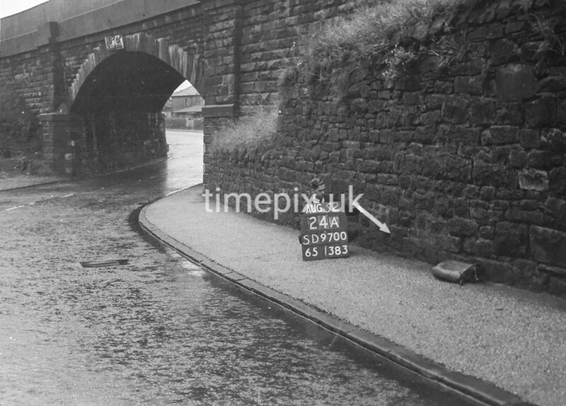 SD970024A, Man marking Ordnance Survey minor control revision point with an arrow in 1950s