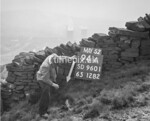 SD960194A, Man marking Ordnance Survey minor control revision point with an arrow in 1950s