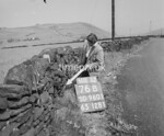 SD960176B, Man marking Ordnance Survey minor control revision point with an arrow in 1950s