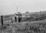 SD970013B, Man marking Ordnance Survey minor control revision point with an arrow in 1950s