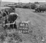 SD950148B, Man marking Ordnance Survey minor control revision point with an arrow in 1950s