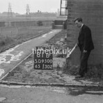 SD950081B, Man marking Ordnance Survey minor control revision point with an arrow in 1950s