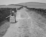 SD960063L, Man marking Ordnance Survey minor control revision point with an arrow in 1950s