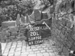 SD970220L, Man marking Ordnance Survey minor control revision point with an arrow in 1950s