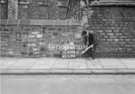 SD970289A, Man marking Ordnance Survey minor control revision point with an arrow in 1950s
