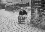 SD970246B, Man marking Ordnance Survey minor control revision point with an arrow in 1950s