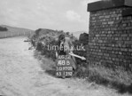 SD970048B, Man marking Ordnance Survey minor control revision point with an arrow in 1950s