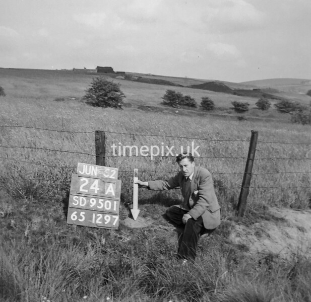 SD950124A, Man marking Ordnance Survey minor control revision point with an arrow in 1950s
