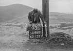 SD980193B, Man marking Ordnance Survey minor control revision point with an arrow in 1950s