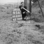 SD950095B, Man marking Ordnance Survey minor control revision point with an arrow in 1950s