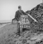 SD960054A, Man marking Ordnance Survey minor control revision point with an arrow in 1950s