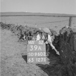 SD960239A, Man marking Ordnance Survey minor control revision point with an arrow in 1950s