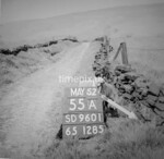 SD960155A, Man marking Ordnance Survey minor control revision point with an arrow in 1950s