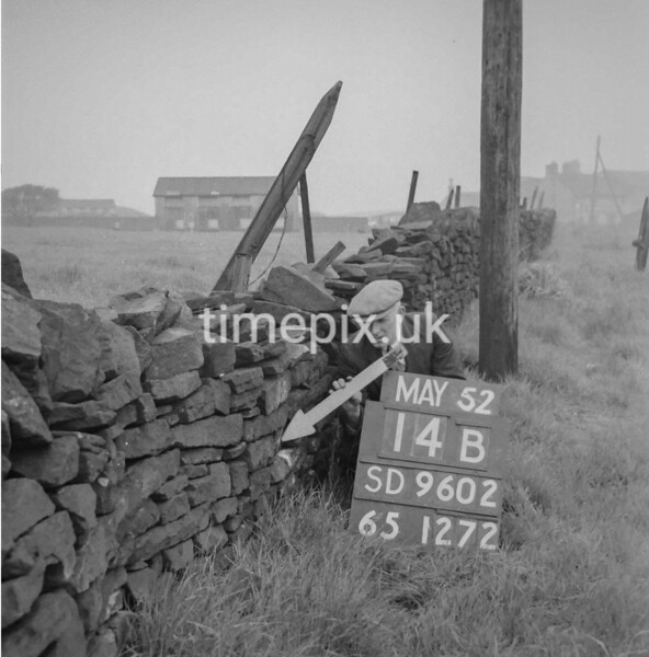 SD960214B, Man marking Ordnance Survey minor control revision point with an arrow in 1950s