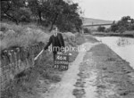 SD970046A, Man marking Ordnance Survey minor control revision point with an arrow in 1950s
