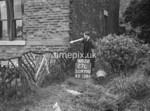 SD970027L, Man marking Ordnance Survey minor control revision point with an arrow in 1950s