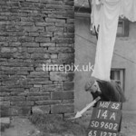 SD960214A, Man marking Ordnance Survey minor control revision point with an arrow in 1950s