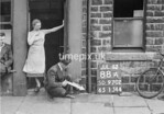 SD970288A, Man marking Ordnance Survey minor control revision point with an arrow in 1950s
