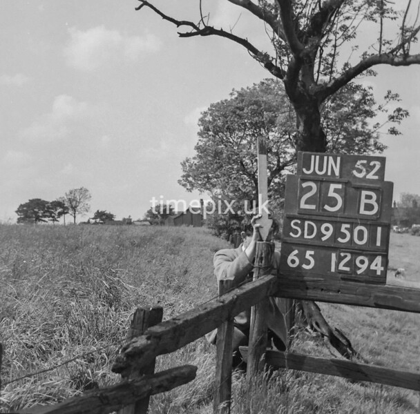 SD950125B, Man marking Ordnance Survey minor control revision point with an arrow in 1950s