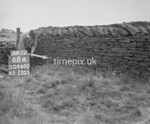 SD960068A, Man marking Ordnance Survey minor control revision point with an arrow in 1950s
