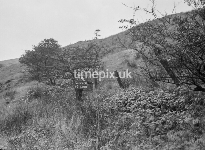 SD970018B, Man marking Ordnance Survey minor control revision point with an arrow in 1950s