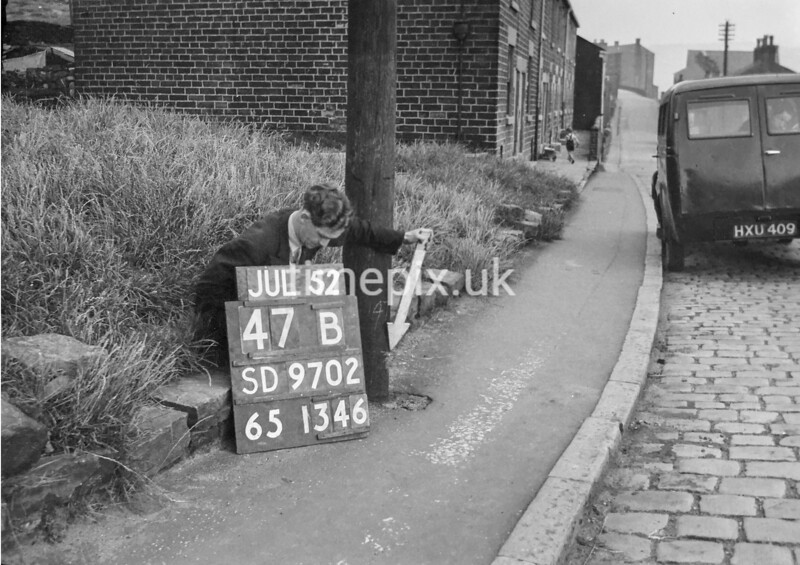 SD970247B, Man marking Ordnance Survey minor control revision point with an arrow in 1950s