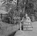 SD950194A, Man marking Ordnance Survey minor control revision point with an arrow in 1950s