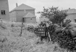 SD980214B, Man marking Ordnance Survey minor control revision point with an arrow in 1950s
