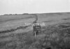 SD980296A, Man marking Ordnance Survey minor control revision point with an arrow in 1950s