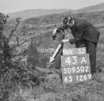 SD950243A, Man marking Ordnance Survey minor control revision point with an arrow in 1950s