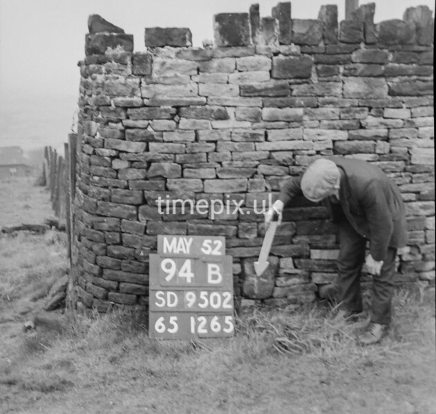 SD950294B, Man marking Ordnance Survey minor control revision point with an arrow in 1950s