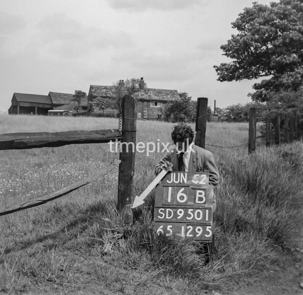 SD950116B, Man marking Ordnance Survey minor control revision point with an arrow in 1950s