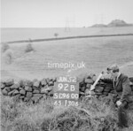 SD960092B, Man marking Ordnance Survey minor control revision point with an arrow in 1950s