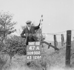 SD950247A, Man marking Ordnance Survey minor control revision point with an arrow in 1950s