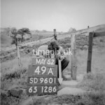 SD960149A, Man marking Ordnance Survey minor control revision point with an arrow in 1950s