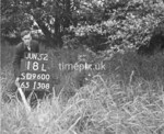 SD960018L, Man marking Ordnance Survey minor control revision point with an arrow in 1950s