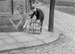 SD970246A, Man marking Ordnance Survey minor control revision point with an arrow in 1950s