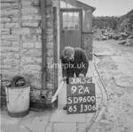SD960092A, Man marking Ordnance Survey minor control revision point with an arrow in 1950s