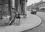 SD970205A, Man marking Ordnance Survey minor control revision point with an arrow in 1950s