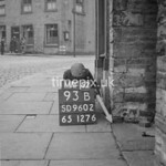 SD960293B, Man marking Ordnance Survey minor control revision point with an arrow in 1950s