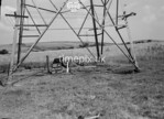 SD950102A, Man marking Ordnance Survey minor control revision point with an arrow in 1950s