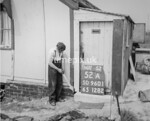 SD960152A, Man marking Ordnance Survey minor control revision point with an arrow in 1950s