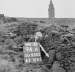 SD950294A, Man marking Ordnance Survey minor control revision point with an arrow in 1950s