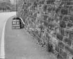 SD970142B, Man marking Ordnance Survey minor control revision point with an arrow in 1950s